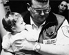 paramedic-holding-child